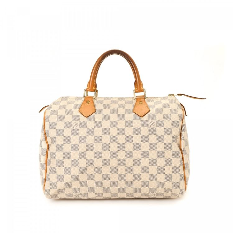4822e2f816fd LXRandCo guarantees the authenticity of this vintage Louis Vuitton Speedy 30  handbag. This chic bag was crafted in damier ebene coated canvas in white.