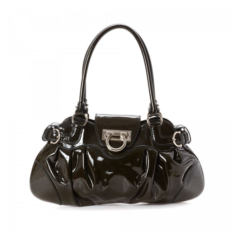 79e8e3d14ed5 LXRandCo guarantees the authenticity of this vintage Ferragamo Marisa  Handbag shoulder bag. This classic pocketbook was crafted in gancini patent  leather in ...