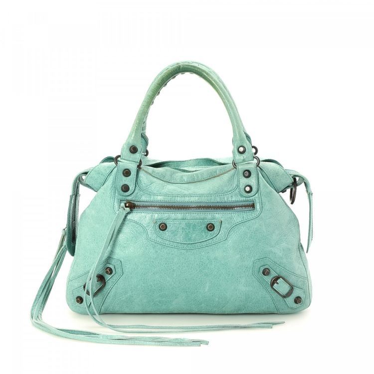 b97959897bd LXRandCo guarantees this is an authentic vintage Balenciaga First shoulder  bag. Crafted in balenciaga chevre chevre, this lovely purse comes in baby  blue.