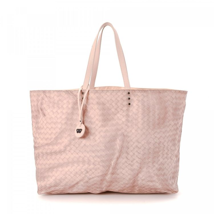 337563f3bb The authenticity of this vintage Bottega Veneta tote is guaranteed by  LXRandCo. Crafted in canvas