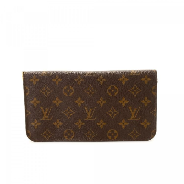 30521cc69356 LXRandCo guarantees the authenticity of this vintage Louis Vuitton Insolite  Organizer wallet. Crafted in monogram coated canvas