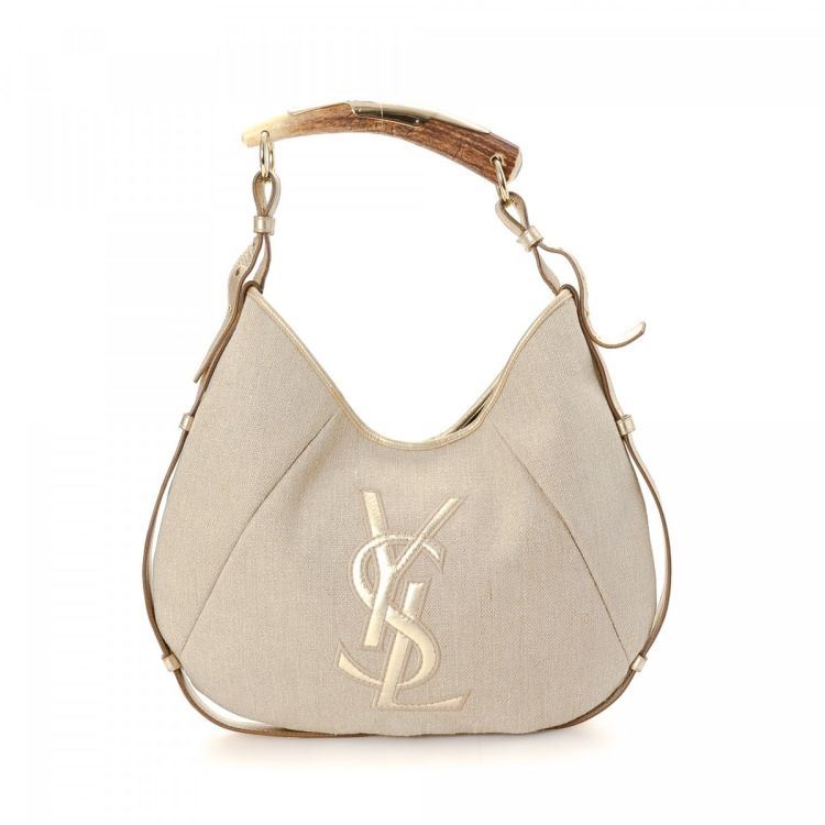 7c4ce986ce LXRandCo guarantees the authenticity of this vintage Yves Saint Laurent  Mombasa shoulder bag. This classic purse comes in beautiful beige canvas.