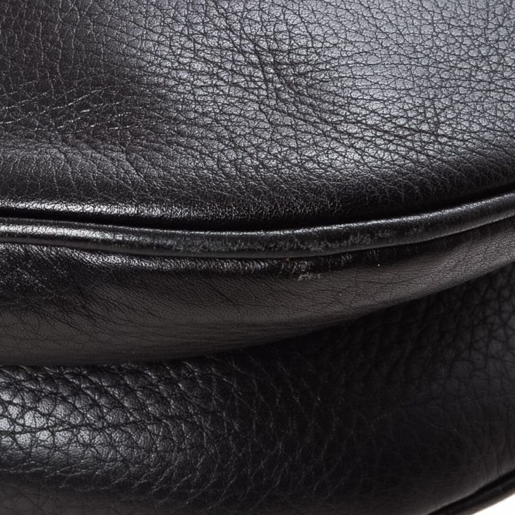 The authenticity of this vintage Dior Saddle Bag handbag is guaranteed by  LXRandCo. This stylish purse was crafted in leather in beautiful black. 23cacba07b