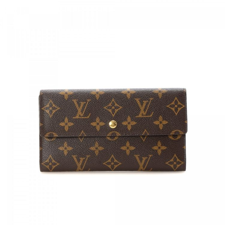 0f0564a8f55b7 LXRandCo guarantees this is an authentic vintage Louis Vuitton Porte-Tresor  International wallet. Crafted in monogram coated canvas