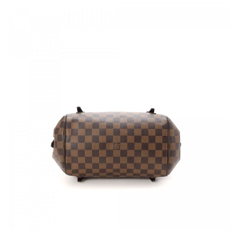 ae5b8e26d39 ... this is an authentic vintage Louis Vuitton Rivington PM shoulder bag.  This iconic purse in beautiful brown is made in damier ebene coated canvas.
