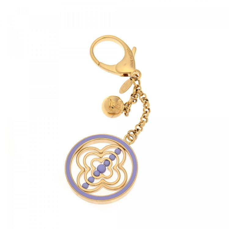 3ac7c0307fd The authenticity of this vintage Louis Vuitton Bag Charm Key Chain is  guaranteed by LXRandCo. This exquisite accessory in beautiful gold tone is  made of ...