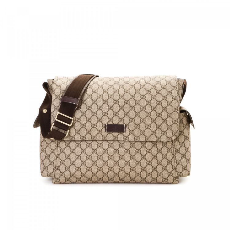 0ec7c7e9d7ea The authenticity of this vintage Gucci Diaper Bag shoulder bag is  guaranteed by LXRandCo. This exquisite shoulder bag was crafted in gg  supreme coated ...