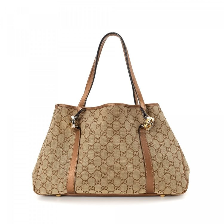 500714e109f The authenticity of this vintage Gucci Twins Medium tote is guaranteed by  LXRandCo. This chic bag was crafted in gg canvas in beige.