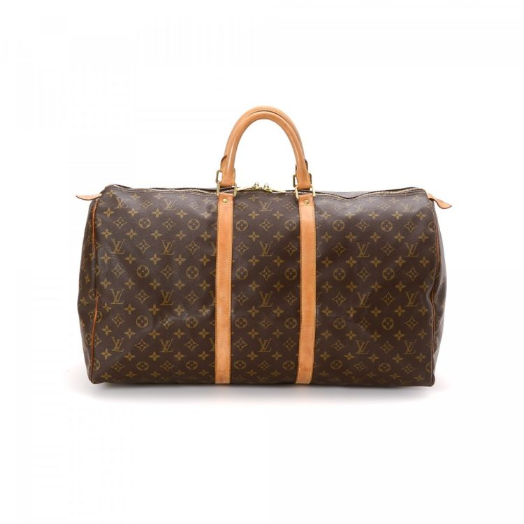 d097c885803b LXRandCo guarantees the authenticity of this vintage Louis Vuitton Keepall  55 travel bag. This everyday carryall was crafted in monogram coated canvas  in ...