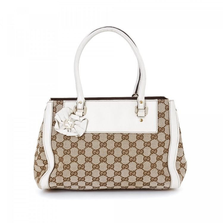df1a9139b9c The authenticity of this vintage Gucci Trophy handbag is guaranteed by  LXRandCo. Crafted in gg canvas