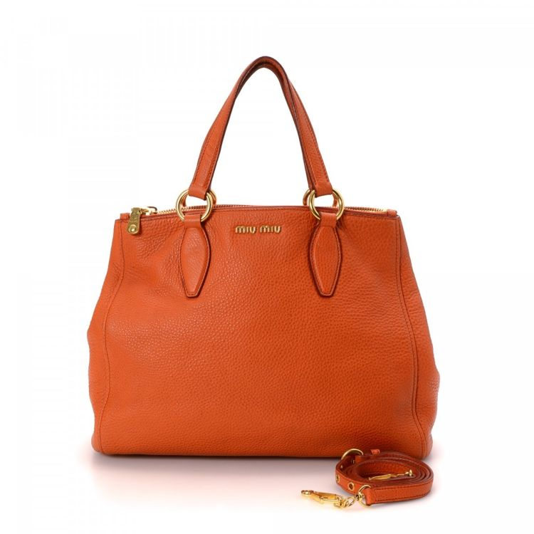 LXRandCo guarantees this is an authentic vintage Miu Miu Two Way Shoulder  bag. This sophisticated shoulder bag comes in orange leather. bf9cb3c286