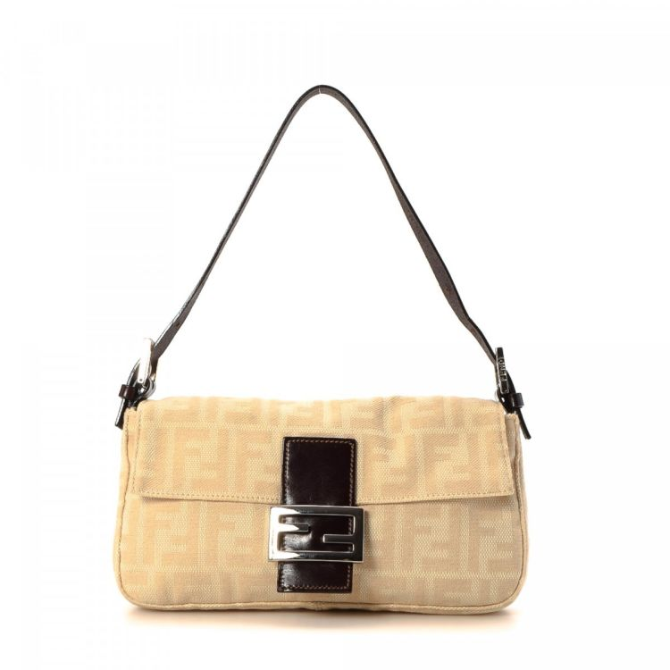 3aba3a1f83 LXRandCo guarantees the authenticity of this vintage Fendi Baguette handbag.  This classic bag was crafted in zucca canvas in beautiful cream.