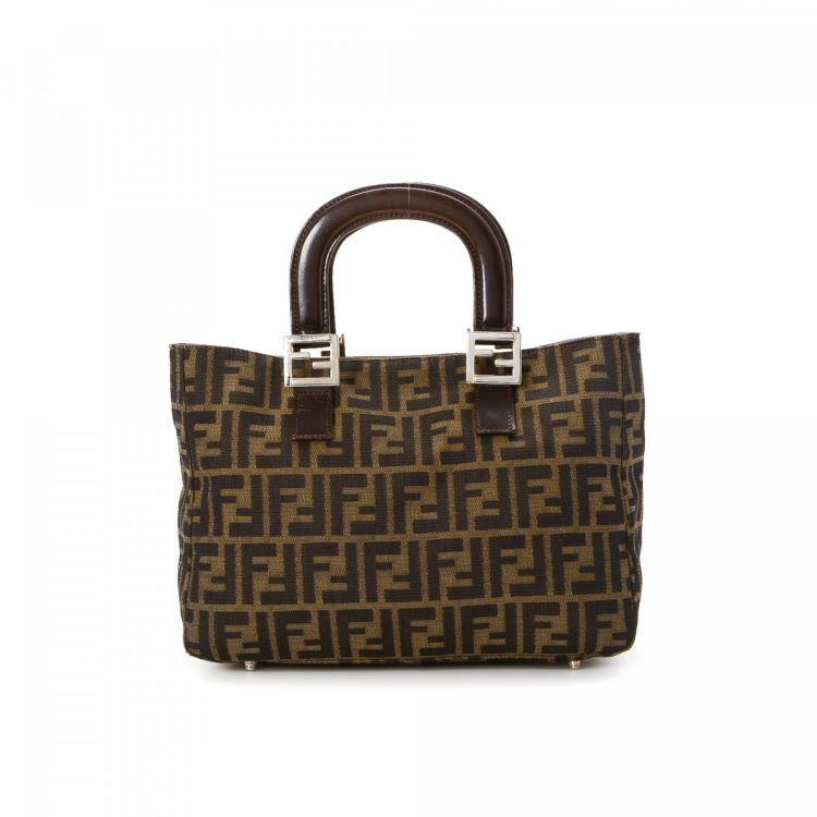 The authenticity of this vintage Fendi Bag tote is guaranteed by LXRandCo.  Crafted in zucca canvas