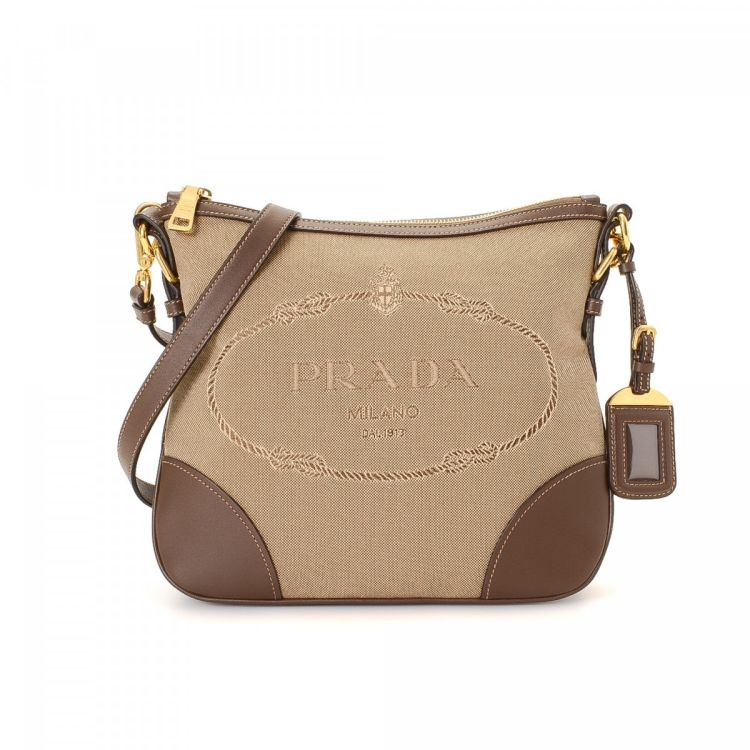 The authenticity of this vintage Prada Logo Jacquard Crossbody Bag messenger    crossbody bag is guaranteed by LXRandCo. Crafted in canvas dce084fb2578e