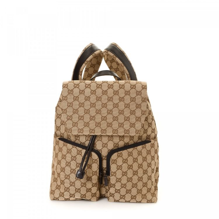 9da7f8070481 LXRandCo guarantees this is an authentic vintage Gucci backpack. This signature  book bag in beautiful beige is made in gg canvas. Due to the vintage nature  ...
