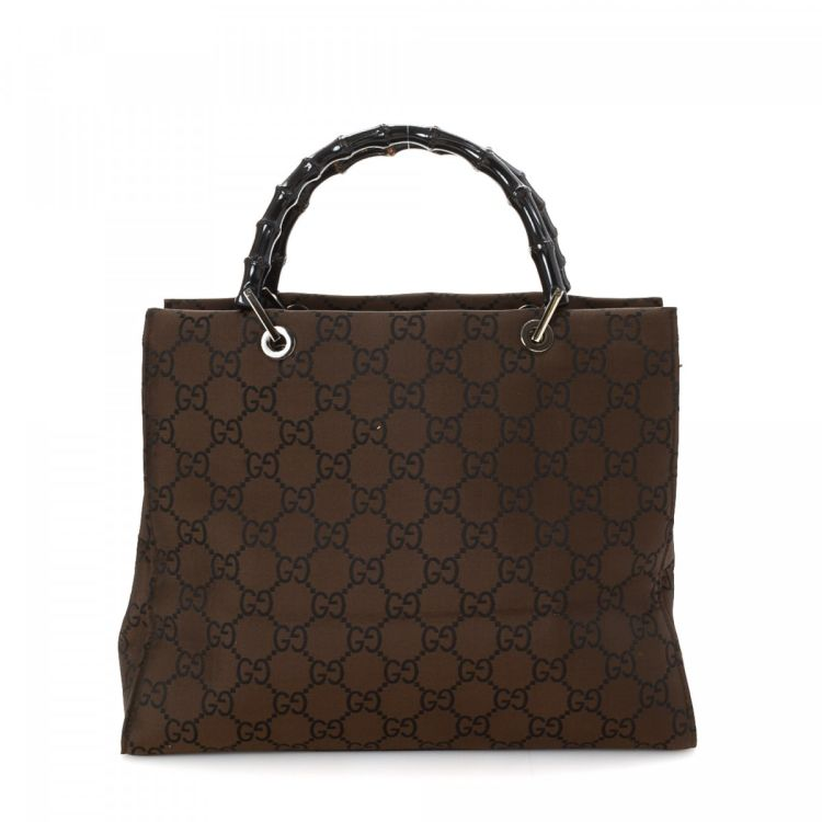 b012ae50173aeb The authenticity of this vintage Gucci handbag is guaranteed by LXRandCo.  This luxurious bag in dark brown is made in bamboo canvas.