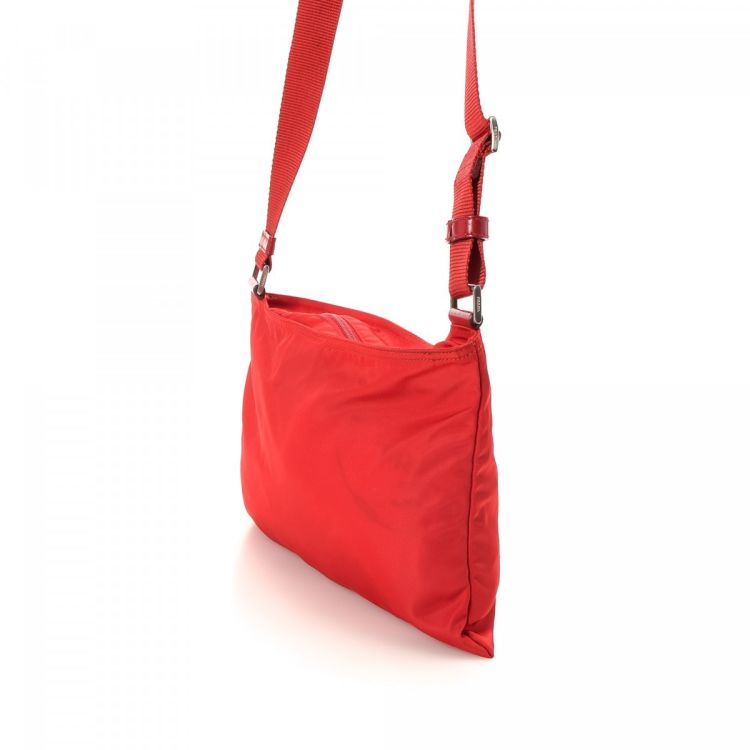 866bc8a258e LXRandCo guarantees the authenticity of this vintage Prada Vela Crossbody  Bag messenger   crossbody bag. This lovely pocketbook in red is made in  tessuto ...