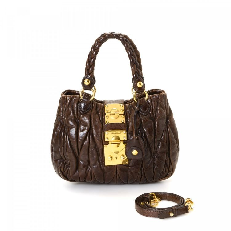 LXRandCo guarantees the authenticity of this vintage Miu Miu Two Way Bag  handbag. Crafted in matelasse leather 65209c5f01970