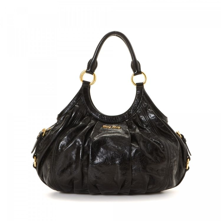 5acff0ef256e LXRandCo guarantees this is an authentic vintage Miu Miu Shoulder Bag  handbag. This stylish bag was crafted in leather in black. Due to the  vintage nature ...