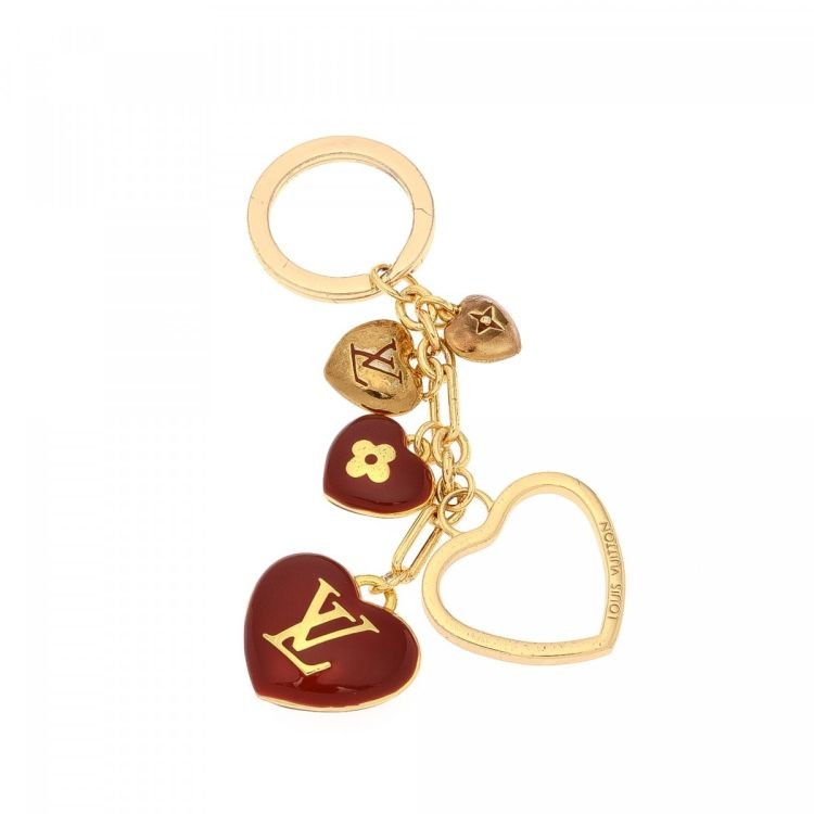 7a264b286c2 The authenticity of this vintage Louis Vuitton Key Chain other jewelry is  guaranteed by LXRandCo. This lovely jewelry in beautiful gold is made of  brass.
