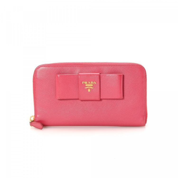 99806fb8ef81 ... inexpensive the authenticity of this vintage prada lux bow wallet is  guaranteed by lxrandco. this
