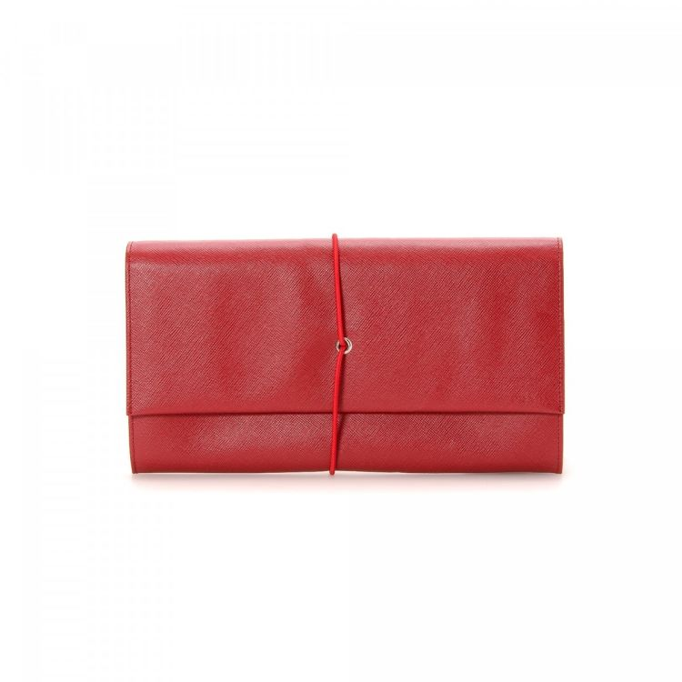 LXRandCo guarantees the authenticity of this vintage Prada Clutch Bag  wallet. Crafted in saffiano leather 25433f70bd77f