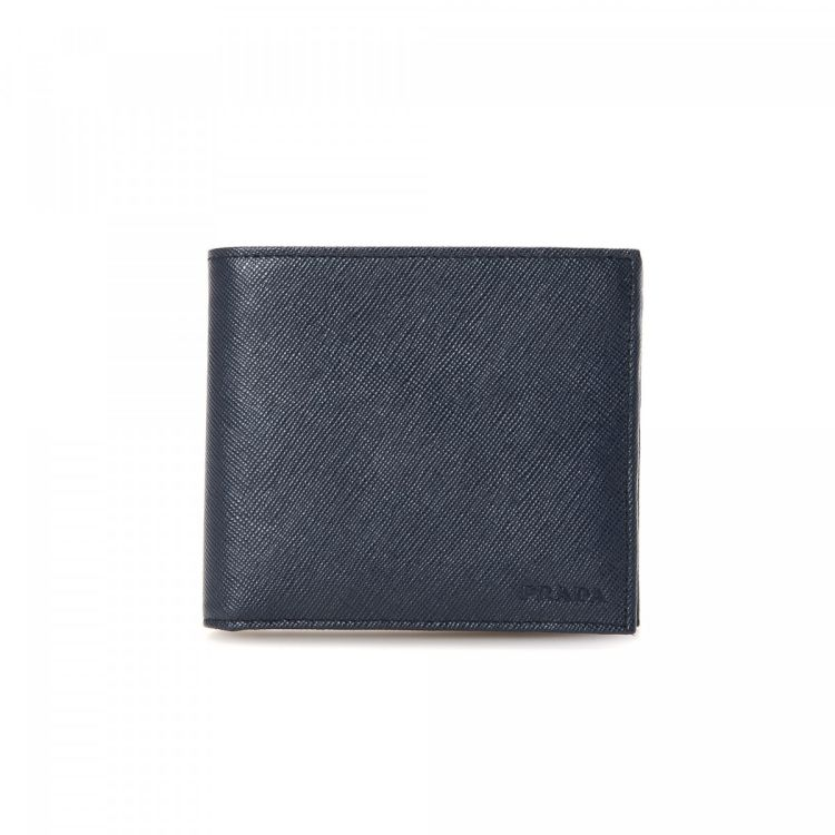 1936d1b8df44 LXRandCo guarantees this is an authentic vintage Prada wallet. Crafted in saffiano  leather, this lovely coin purse comes in navy. Very good condition* (A)