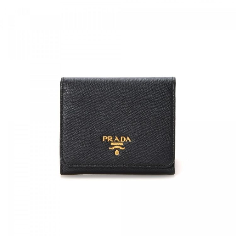 365312f57a36 LXRandCo guarantees the authenticity of this vintage Prada Saffiono wallet.  This luxurious card holder was crafted in saffiano leather in black.