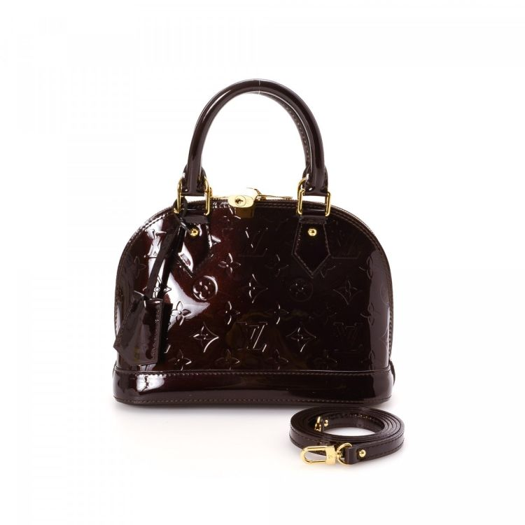 3b93d47d6132 LXRandCo guarantees the authenticity of this vintage Louis Vuitton Alma BB  handbag. This exquisite handbag in amarante is made in vernis patent leather .