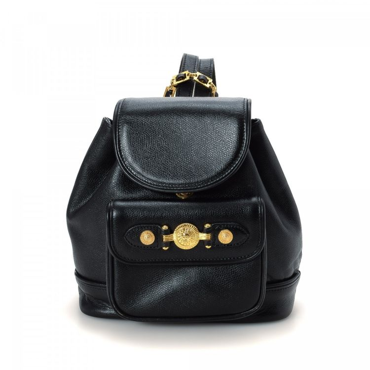 34a21949bb The authenticity of this vintage Versace backpack is guaranteed by  LXRandCo. This refined backpack comes in black leather. Due to the vintage  nature of this ...
