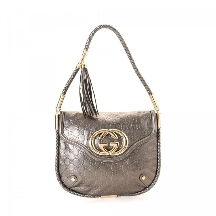 a1428ddd6ccbae LXRandCo guarantees this is an authentic vintage Gucci Britt Tassel shoulder  bag. This stylish pocketbook was crafted in guccissima leather in silver.