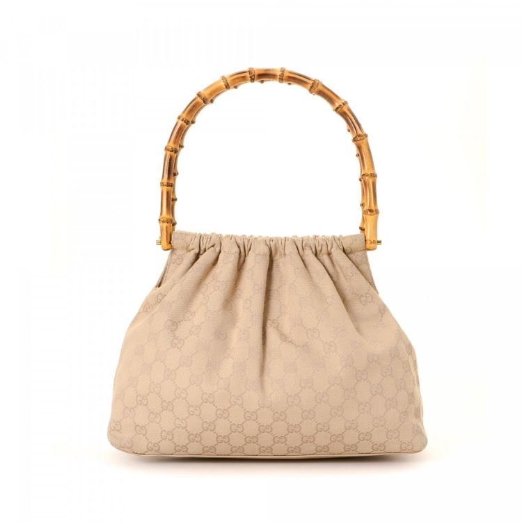 f3aa453bbaa The authenticity of this vintage Gucci GG handbag is guaranteed by LXRandCo.  Crafted in bamboo canvas