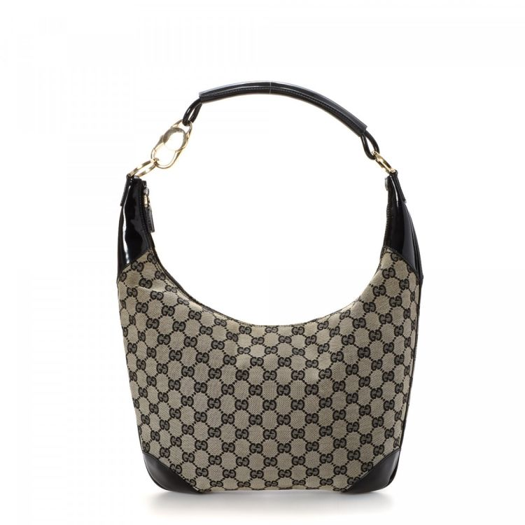 8e23458ce20 LXRandCo guarantees the authenticity of this vintage Gucci shoulder bag.  This everyday bag in grey is made in gg canvas. Due to the vintage nature  of this ...