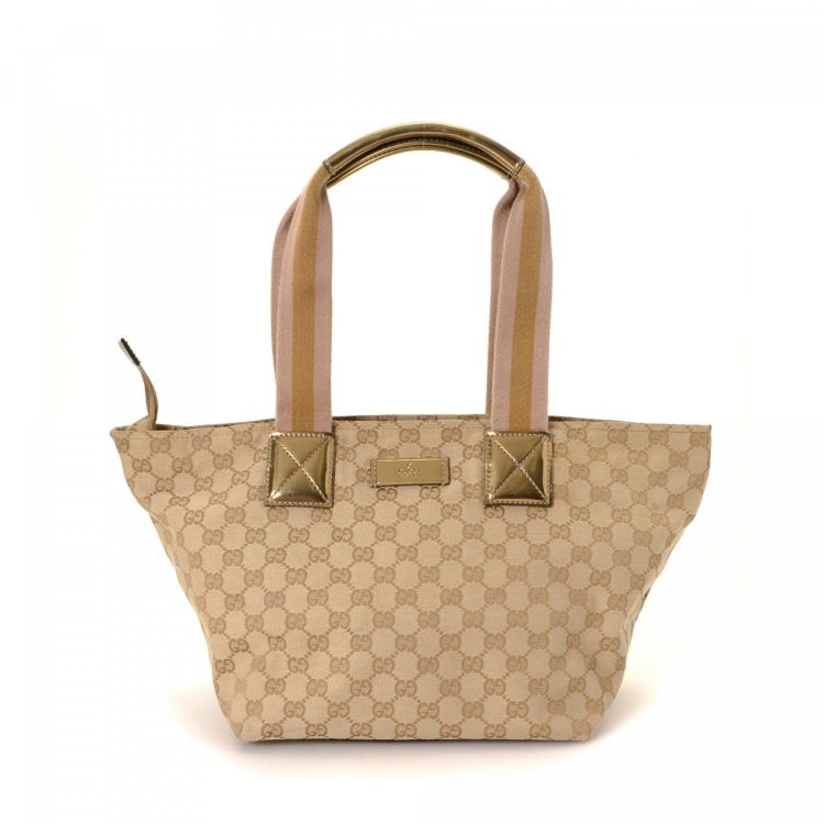 eb6f86ea54d LXRandCo guarantees the authenticity of this vintage Gucci tote. Crafted in gg  canvas