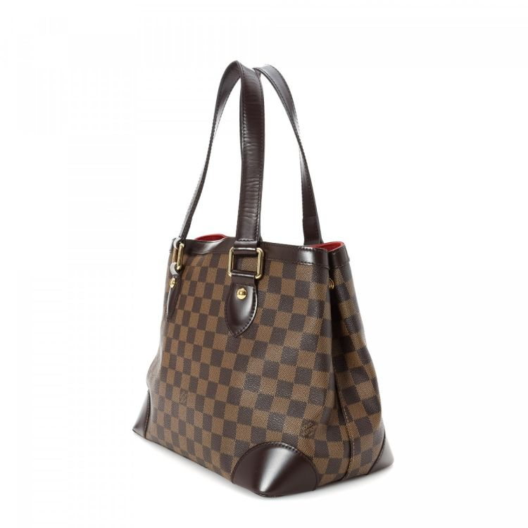 04a3b35e16fa LXRandCo guarantees the authenticity of this vintage Louis Vuitton  Hampstead PM tote. This sophisticated tote bag in brown is made in damier  ebene coated ...