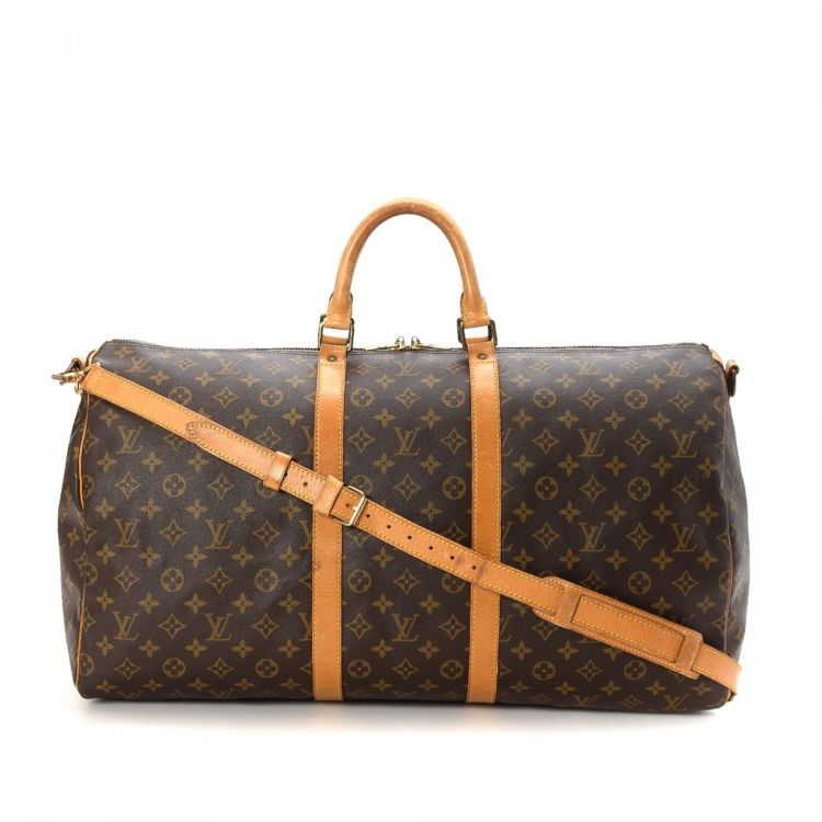 2a2c4a6dc470 LXRandCo guarantees the authenticity of this vintage Louis Vuitton Keepall  55 Bandouliere travel bag. This everyday boston bag in brown is made in  monogram ...