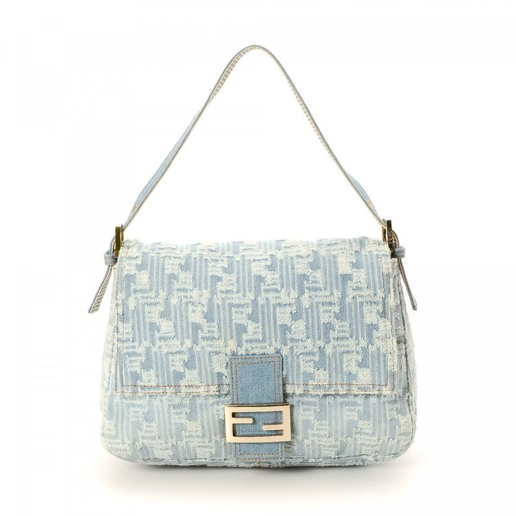 LXRandCo guarantees this is an authentic vintage Fendi Mamma Baguette  shoulder bag. This iconic pocketbook was crafted in denim in beautiful blue  jean. 56c9f00c39a66