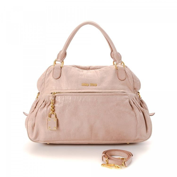 dc952e047be LXRandCo guarantees this is an authentic vintage Miu Miu Nappa Charm Two  Way Bag handbag. Crafted in leather