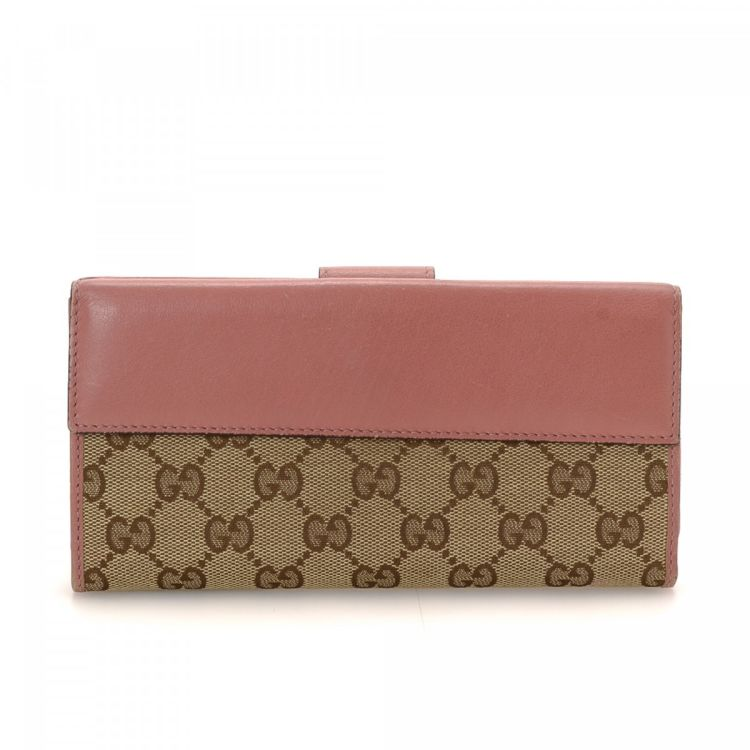 fd7fecf709c0 LXRandCo guarantees this is an authentic vintage Gucci Heart Continental  wallet. This chic compact wallet in beautiful beige is made in gg canvas.