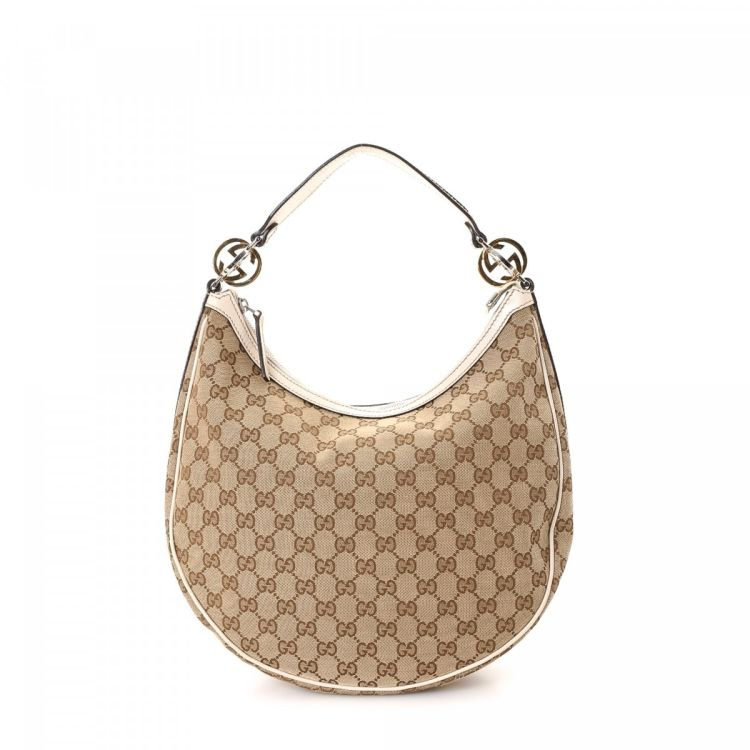 1fc809d8f962 LXRandCo guarantees the authenticity of this vintage Gucci Twins Hobo Bag  shoulder bag. This practical bag was crafted in gg canvas in beautiful  beige.