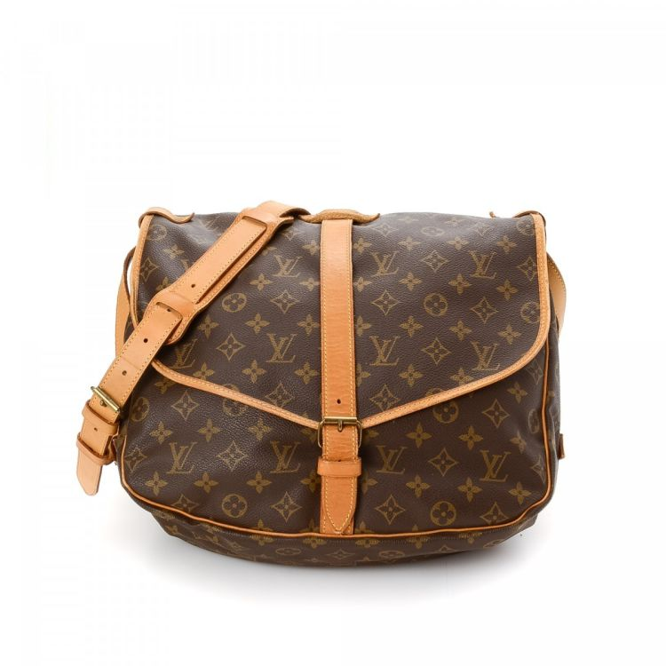 28f73d34e1c0 ... guarantees this is an authentic vintage Louis Vuitton Saumur 35  shoulder bag. This beautiful pocketbook was crafted in monogram coated  canvas in brown.