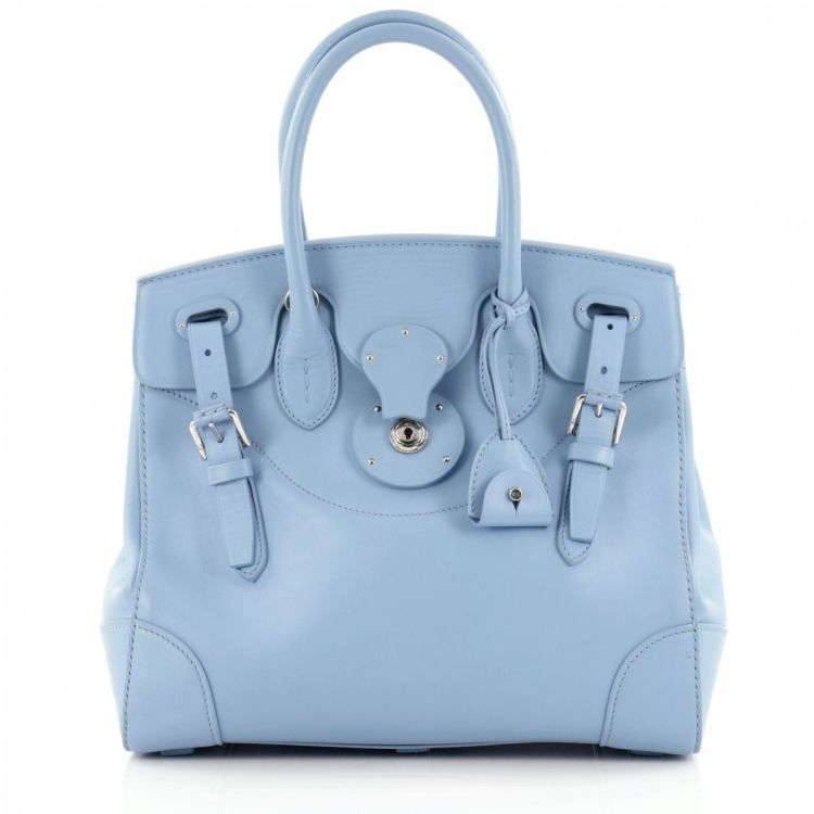 e1d1e1ceb7 LXRandCo guarantees the authenticity of this vintage Polo Ralph Lauren Soft  Ricky Handbag 33 shoulder bag. This stylish bag in blue is made of leather.