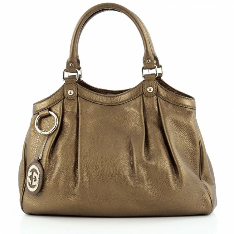 e4e5c44d656ce7 LXRandCo guarantees this is an authentic vintage Gucci Sukey Tote Medium  shoulder bag. This beautiful purse was crafted in leather in metallic  bronze.