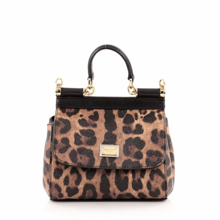 32c928f5b35d The authenticity of this vintage Dolce   Gabbana Miss Sicily Leopard Print  Micro handbag is guaranteed by LXRandCo. This elegant bag was crafted in  leather ...