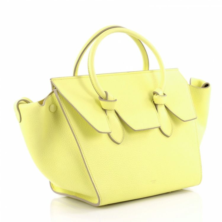 fa67f352c4ef The authenticity of this vintage Céline Tie Knot Tote Grainy Mini handbag  is guaranteed by LXRandCo. This stylish purse was crafted in leather in  yellow.