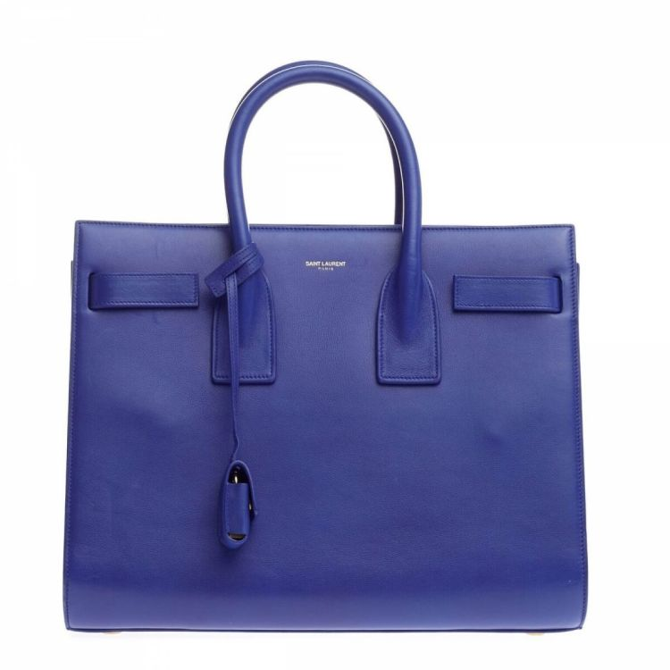 97da91f6d9867 ... of this vintage Yves Saint Laurent Sac de Jour handbag is guaranteed by  LXRandCo. Crafted in leather