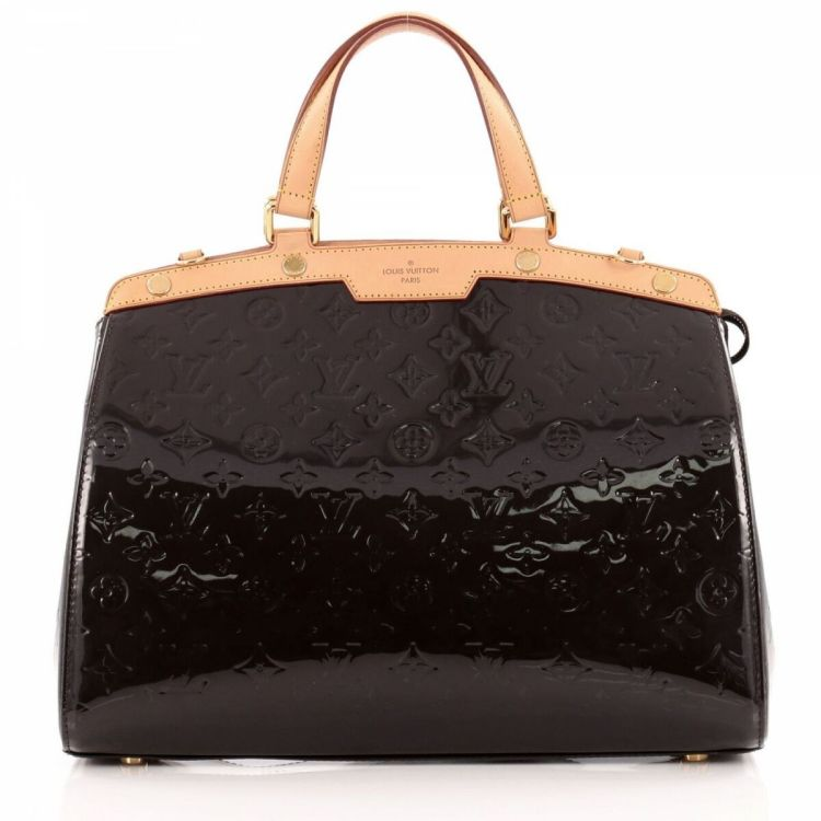 17f7fe95651e ... of this vintage Louis Vuitton Brea Monogram GM shoulder bag is  guaranteed by LXRandCo. This elegant purse in amarante is made in vernis  patent leather.