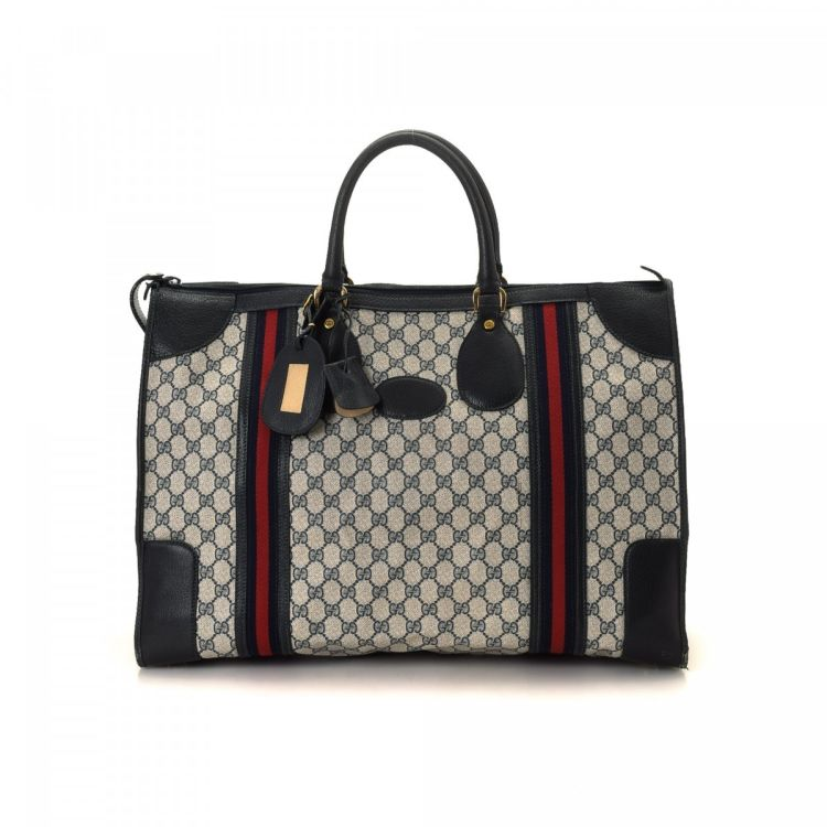 00137bbec8d The authenticity of this vintage Gucci travel bag is guaranteed by LXRandCo.  This iconic garment bag in beautiful grey is made in gg supreme coated  canvas.
