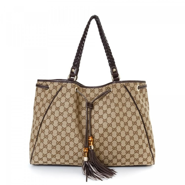 fe1d49138b21 LXRandCo guarantees the authenticity of this vintage Gucci GG Tassel tote.  Crafted in bamboo canvas