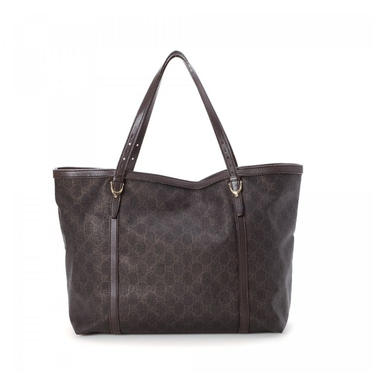 e53dd14a1 LXRandCo guarantees this is an authentic vintage Gucci tote. This beautiful tote  bag was crafted in gg supreme coated canvas in brown.